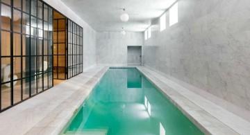 contemporary indoor lap pool with glass door