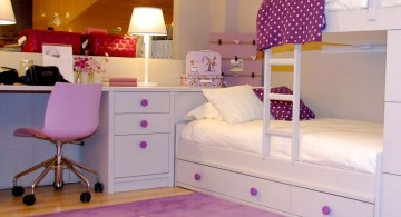 desk and bed combination with purple white star rug