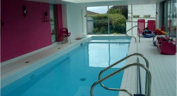 enclosed swimming pool with pink wall