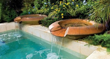 featured image of pools with waterfalls coming down from rustic twin bowls