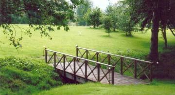 flat DIY garden bridge with steel railings