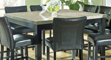 granite dining room table with black chairs