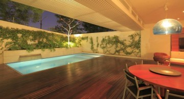 in ground enclosed swimming pool with glass walls