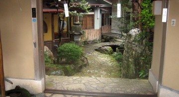 japanese garden designer with paper lamps