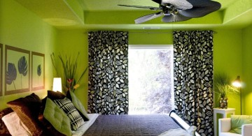 lime green bedroom with black curtain and leaf shaped fan