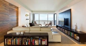 long living room with bookshelves