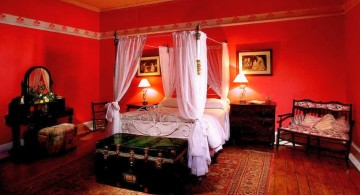 luxurious red bedroom walls with canopy bed