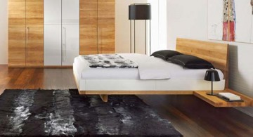 minimalist modern floating bed coupled with nice wooden floor and gorgeous black rug