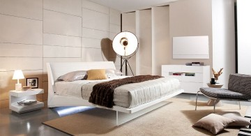 modern floating bed with large floor lamp