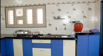 modular kitchen in blue and white with patterned tile
