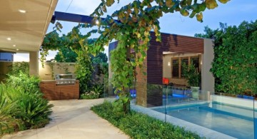 pool for small yard with outdoor fireplace