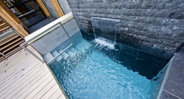pool for small yard with wall waterfall and glass door