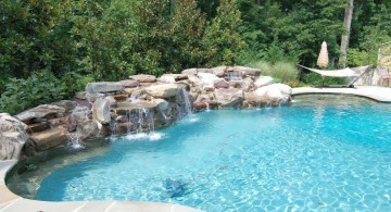 pool waterfall ideas with river stone
