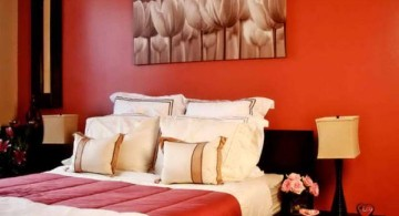 red bedroom walls with flower painting
