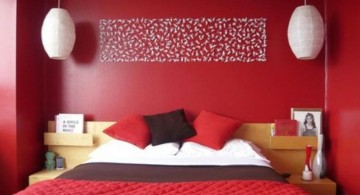 red bedroom walls with wall decor