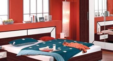 red bedroom walls with wooden floor