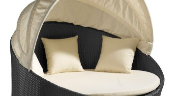 round bed frame in monochrome with fold in canopy