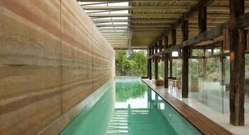 semi indoor lap pool with wooden deck