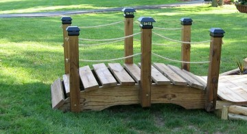 short DIY garden bridge with rope railings