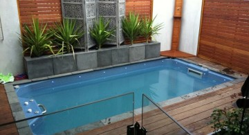 simple small pool ideas with tall wooden walls