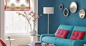 turquoise living room decor with pink cushions