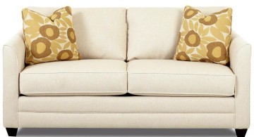unique sleeper sofa wih patterned cushions