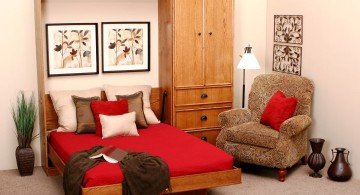 wall bed couch with red bedding and wall decor