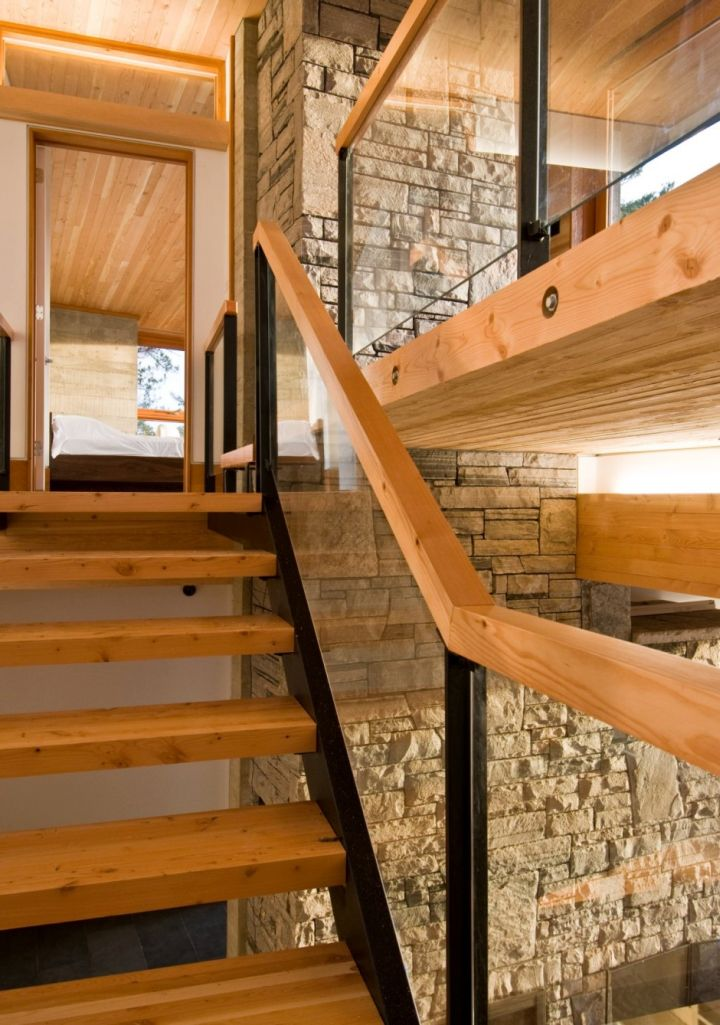 wood staircase with patterned glass railing