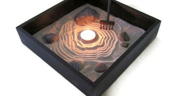 zen style mini japanese garden with candle