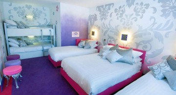 funky bedroom ideas with pale wallpaper and multiple beds