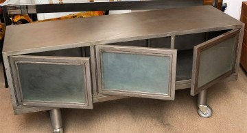 metal credenza with three swing doors and mash panel
