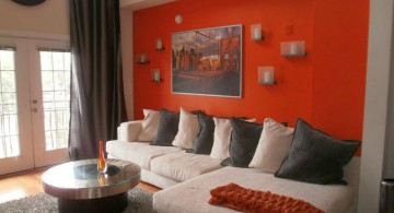 minimalist red wall accent with L shaped sofa