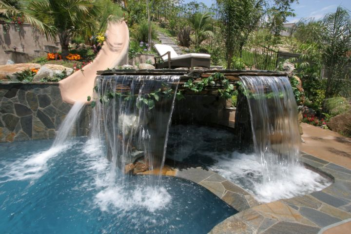 pool waterfall ideas with large stone