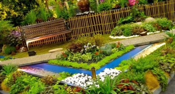 terraced flower garden with small pond and garden chair