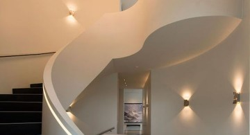 ultramodern lake house spiral staircase
