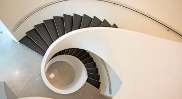 ultramodern lake house spiral stairs