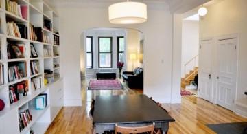built in bookshelves in dining room with wooden floor