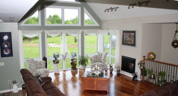 cathedral ceiling living room with large french windows