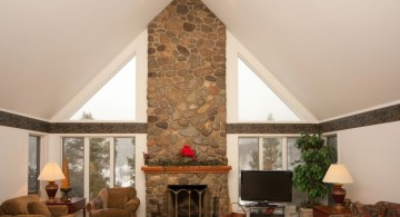 cathedral ceiling living room with receased lighting