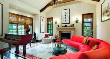 cathedral ceiling living room with red half moon sofa and a piano