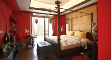 modern asian bedroom with canopied bed and red walls