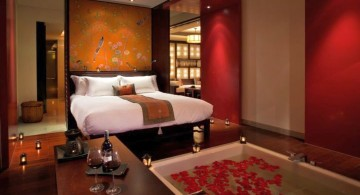 modern asian bedroom with floor tub and flower petals