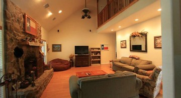 warm and cozy cathedral ceiling living room with fireplace